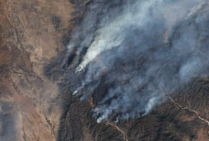 How can satellite images help contain the spread of wildfires in Mexico?
